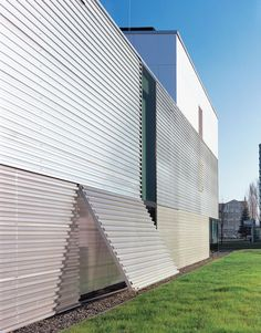 Corrugated metal as facade material. Can also be used for openings. Fabrication Hall, Saalfeld