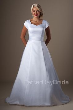 Tatum | This classic A-line modest wedding gown features a darling waistband, flattering princess seams, sweetheart neckline and a corset back.    Gown available in Ivory or White    *Gown pictured in White    Available at LatterDayBride.com or in store at Gateway Bridal | Home of the LatterDayBride Collection in SLC, UT