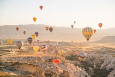 Places to visit in Cappadocia, Turkey - Hot air balloons over Fairy Valley at sunrise.