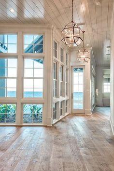 Beach house with reclaimed hardwood floors   Urban Grace Interiors by delia