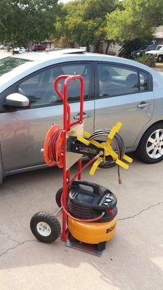 Woodworking Tools Picture of DIY Compressor Cart.jpg - Well since my garage is a mancave/tinkershop, my compressor and hoses are stored at the rear of my property in my shed and it has been cumbersome to make several . Diy Garage Storage, Shop Storage, Garage Organization, Storage Ideas, Garage Shelving, Organization Ideas, Storage Cart, Trailer Storage, Storage Units