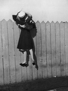 A sailor and his sweetheart kiss goodbye, 1940s