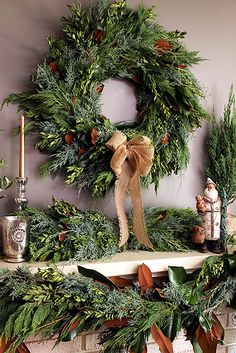 Fresh Bunches of Magnolia, firs & cedars with matching garland create a…
