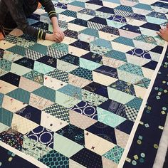 All the blues and greens! @erincharter 's Hexcentric quilt. Photo by Karyn Valino.