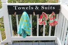 """Rather than have your kids drop their towels on the ground in a wet, soppy mess, hang this cute """"rack"""" to keep suits and towels organized.  Get the tutorial at The Summery Umbrella."""