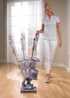 Lady Holding The Shark Rocket Ultralight Vacuum I Am