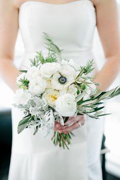 Modern white anemone accented wedding bouquet: http://www.stylemepretty.com/wisconsin-weddings/madison-wi/2015/11/23/modern-art-gallery-wedding-3/ | Photography: Carly McRay - http://www.carlymccrayphotography.com/