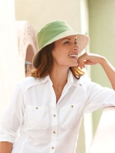 """<h2 class=""""mti_font_element"""">Our Reversible Bucket Hat holds a whole lot of sun protection inside its fun and chic design. Made from one layer of canvas and one layer of Solumbra fabric, it's totally reversible with an almost 4"""" brim in front that narrows to an almost 3"""" brim in back. <i class=""""mti_font_element"""">(Box Shipment Surcharge may apply. See <a href=""""#"""" class=""""mti_font_element"""">Shipping Information</a>.)</i></h2>"""