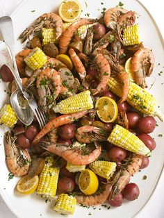 Shrimp and Sausage Boil Recipe from Bring an easy-to-share platter of this low-country favorite recipe to the table and everyone will be impressed. Toss in the lemon halves at the last to squeeze over the shrimp. Oh this brings back so may memories. Cajun Recipes, Fish Recipes, Seafood Recipes, Great Recipes, Dinner Recipes, Cooking Recipes, Favorite Recipes, Healthy Recipes, Yummy Recipes