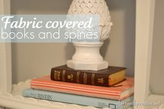 Books are awesome when styling shelves, tables, mantels, etc.  They are readily available, inexpensive, and great to add height to other decorative pieces.  But sometimes the bright blue or yellow spines just don't work for your color palette. Fabric is an easy option to use to update the books themselves or just the spines to add that pop of color.
