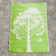Tree Floormat 6ft x 4ft Lime-Off-white by The Koko Company. $49.99. 4 x 6 ft. reversible rug. Lime and off-white. 100% polypropylene - durable and easy to clean. 1-year limited warranty. Spray with hose to clean and drip dry. Tree Floormat Eye-catching Design Color the ground you walk on. These mats are perfect for high traffic areas that need a little brightening, plus mats are recyclable at the end of their life-cycle. This graphic tree design will bring a lit...