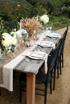 Use a burlap table runner, put vases of flowers, and Mason jar candles.