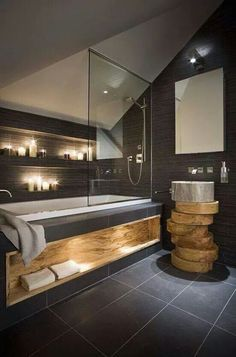love the built in shelf for candles by tub... or would make a great spot for a fireplace as well!