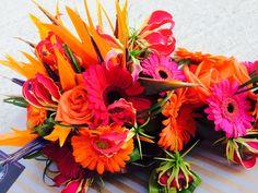Orange, hot pink, gloriosa lilies, bird of paradise, gerberas, roses. Tropical bouquet. www.weddingflowersincornwall.co.uk