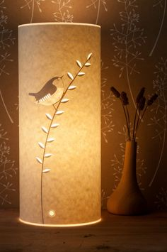 Hannah Nunn's beautiful paper lamps. Such a warm glow...  wren lamp - Radiance
