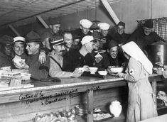 American and French Servicemen enjoy themselves at an American Red Cross canteen in Bordeaux, France,