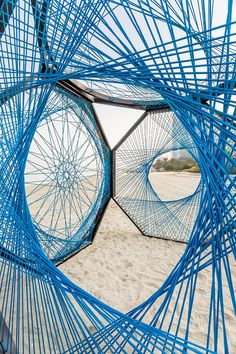 aljoud lootah weaves sculptural seaside installation using emirati fishing techniques