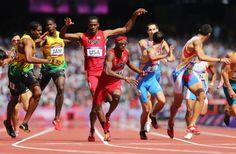 Joshua Mance of the U.S passes the baton to Tony McQuay of the U.S. during the Men's 4 x 400m Relay