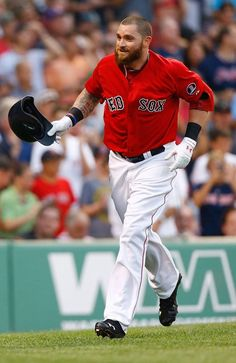 BOSTON, MA - JULY 19: Jonny Gomes #5 of the Boston Red Sox celebrates after hitting a two-run home run in the second inning off of Andy Pettitte #46 of the New York Yankees during the game on July 19, 2013 at Fenway Park in Boston, Massachusetts. (Photo by Jared Wickerham/Getty Images)