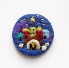 Needle felted brooch, 'Nativity',  'Oh little town of Bethlehem..' Wool, Holy Family, Gift for Teacher, Auntie, Mother by iwantcraft on Etsy https://www.etsy.com/listing/211362153/needle-felted-brooch-nativity-oh-little