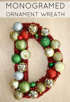 What an interesting twist to the traditional wreath--a Monogrammed Ornament Wreath! Even better, this makes a great DIY project! Handmade Christmas Crafts, Christmas Projects, Holiday Crafts, Christmas Holidays, Christmas Ideas, Xmas, Holiday Ideas, Holiday Time, Christmas Stuff