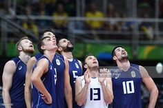 Italy's Ivan Zaytsev, Italy's Simone Giannelli, Italy's Osmany Juantorena, Italy's Massimo Colaci and Italy's Filippo Lanza look up at a screen to watch an official review during the men's Gold Medal volleyball match between Italy and Brazil at the Maracanazinho stadium in Rio de Janeiro on August 21, 2016, at the Rio 2016 Olympic Games. / AFP / Johannes EISELE