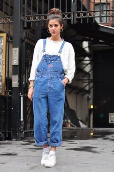 street style 90s denim dungarees worn with oversize jumper and trainers