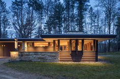 SALA Architects and Braden Construction renovated this amazing home originally designed by Frank Lloyd Wright, sited in Grant, Minnesota. Concrete Light, Concrete Floors, Water Heating Systems, Usonian, Residential Construction, Frank Lloyd Wright, Maine House, Exterior Doors, Home Renovation