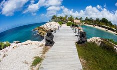 Bibi Island - Curacao - This little bridge leads to Bibi Island which separates the serene lagoon at Baose from the Caribbean sea. There is a little meditation garden and beach bungalows. Curacao is part of the ABC islands just off the coast of Venezuela. For better geographical perspective, Venezuela is directly to the left. Some people hate the bend of the fish eye. I think it's fun.