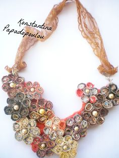 Handmade necklace made from magazine pages and decorated with pearls . ( colors brown-orange) Working time 7 hours