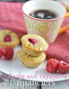 Pistachio and Raspberry Financiers are the perfect little sweet to serve when you want a fun pick me up. Made with a base of pistachio and topped with one tart raspberry, these elegant but easy treats are the perfect accompaniment to coffee or tea.