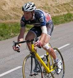 """Jens Voigt crashed so hard he trashed his bike. It was taking so long to get """"support"""" from his team car that he rode a spectators bike to the finish."""