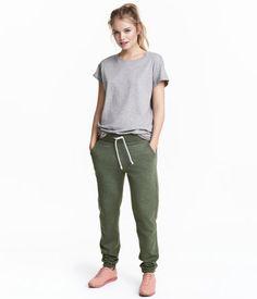 Khaki green. Soft sweatpants with an elasticized drawstring waistband, side pockets, and ribbed hems. Brushed inside.