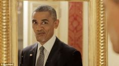 President Barack Obama makes a silly face while looking at himself in the mirror in the Buzzfeed video