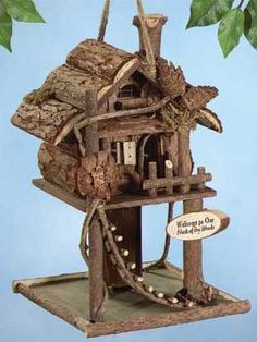"""""""I have one similar to this one using grape vine. Log Cabin Birdhouse Welcome birds to your """"neck of the woods"""" with this fantastic wooden feeder. It has a rustic ladder and is decorated with twigs and pinecones. 7 1/2"""" x 7 3/4"""" x 12"""" high."""