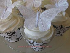 Wedding Cupcakes using colored butterflies and flowers