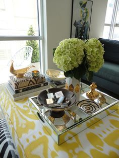 Hallie Henley's living room via La Dolce Vita.  Loving the lucite coffee table.