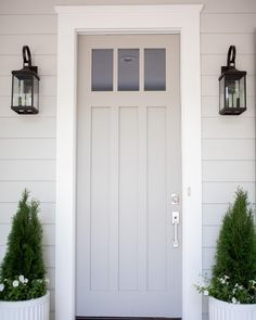 grey exterior house colors Come see why Sherwin Williams Dorian Gray is one of my favorite gray paint colors for just about any space in your home! A true, warm, gray paint. Painted Exterior Doors, Exterior Gray Paint, White Exterior Houses, Exterior Paint Colors For House, Painted Front Doors, Grey Houses, Paint Colors For Home, Exterior Trim, Gray Siding