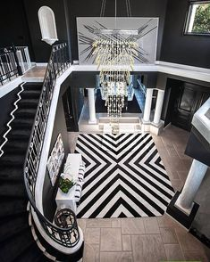 Black is not your typical wall color, but it looks pretty special in this grand foyer ...   by Orange Coast Interior Design  