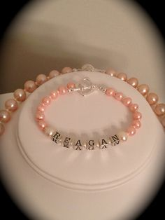 A close up of the baby bracelet.  Teeny pink pearls and sterling silver components made up this precious little heirloom!