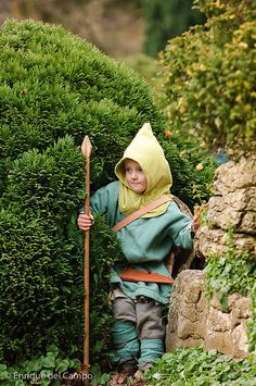 Front of the little viking boy.