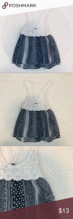 Hollister Flowy Pattern Tank Cute summer tank top with a crochet top and flowy sheer navy pattern bottom. Barely worn and still in good condition. Hollister Tops Tank Tops