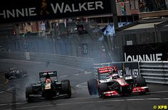 Heikki Kovalainen, Caterham CT01, Jenson Button, McLaren MP4-27.