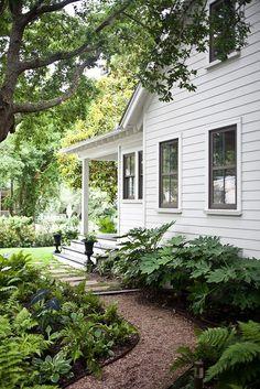 shade, crunchy gravel path, white clapboard, & a porch.