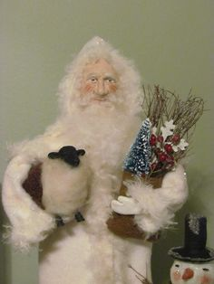 Primitive Vintage Early Style German Folk Art Santa Doll Winter Snowman Sheep Wooden Base Sweetpeas Primitives. $89.00, via Etsy.