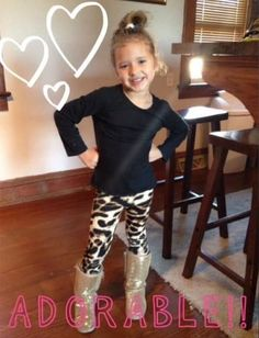 How stinkin' cute is Ava!?!? Loving the pose!She sure is looking sassy in our kids leopard leggings!!