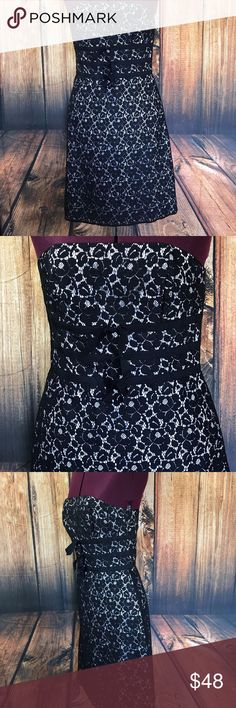 """White House Black Market Sheath Lacey Floral Dress Great dress by White House Black Market  Back Center Zip  Soft boning at sides and front  Ribbon detail at front  Sleeveless  Lined  54% Nylon,46% cotton, lining is 100% polyester  Size 4  Measures 16"""" across bust  Measures 29.5"""" long from center back  Gently worn, very good condition White House Black Market Dresses"""