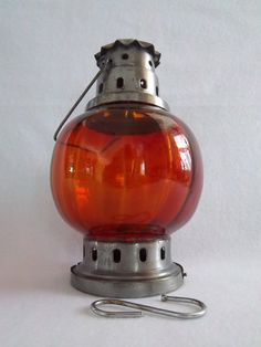 Vintage Glass Lantern featuring a Deep Orange Globe on a Metal Base