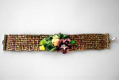As taught at the Bead and Button Show in Milwaukee. This class was sold out at Bead and Button but now you can buy the kit. The fantastic stitch is Mosaic Stitch. This stitch is most unique and quick. There are ribbon embellishments that finish off this beautiful bracelet.