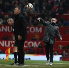 Manager Jose Mourinho of Manchester United throws the ball back into play during the Emirates FA Cup Third Round match between Manchester United and...